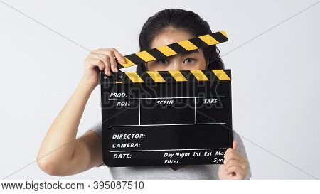Girl Or Woman Wear Contact Lenses And Hand's Holding Black Clapper Board Or Movie Slate Use In Video