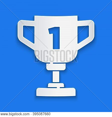 Paper Cut Award Cup Icon Isolated On Blue Background. Winner Trophy Symbol. Championship Or Competit