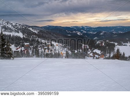Picturesque Winter Windy And Cloudy Morning Alps. View Of Famous Ukrainian Dragobrat Ski Resort From