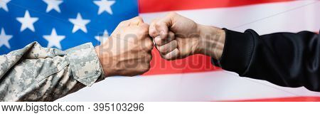 Cropped View Of Soldier Fist Bumping With Civilian Man Near American Flag On Blurred , Banner