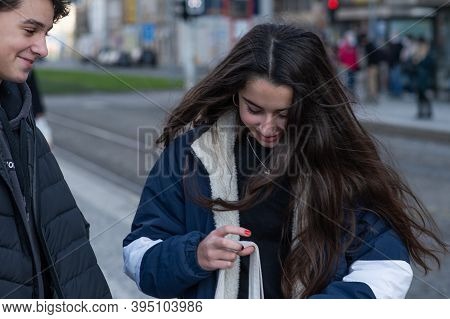Czech Republic. A Young Couple Are Waiting For A Tram At Hradcanska Tram Stop During Quarantine. Thi