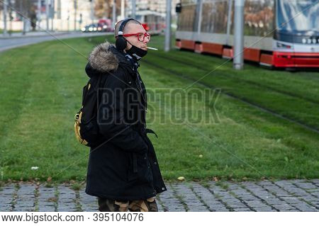 Czech Republic. A Man Waiting For A Tram At Hradcanska Tram Stop During Quarantine. This Is A Lockdo