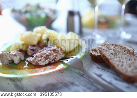 Close-up Of Delicious Meal. Meat Cutlet And Potato Served On Plate. Slices Of Bread. Tasty Dish For
