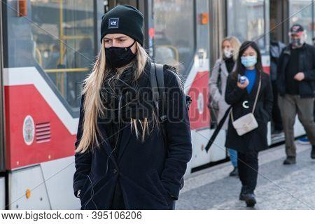 11/16/2020. Prague. Czech Republic. A Woman Wearing A Mask Is Getting Of The Tram At Hradcanska Tram