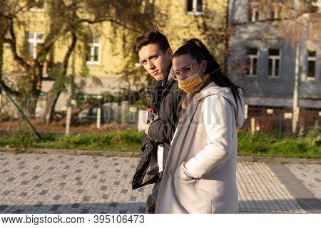 11/16/2020. Prague, Czech Republic. A Couple Is Walking Close To Hradcanska Tram Stop During Quarant
