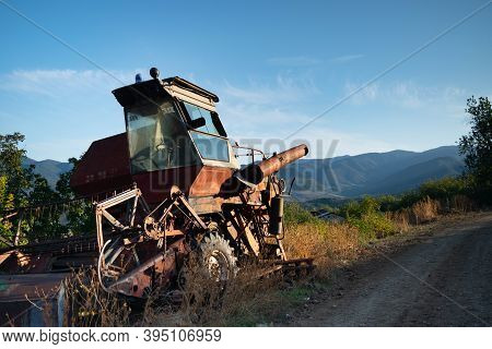 Old Abandoned Rusty Combine Harvester On The Streets Of Azokh Town Part Of The Janapar Trail In Nago