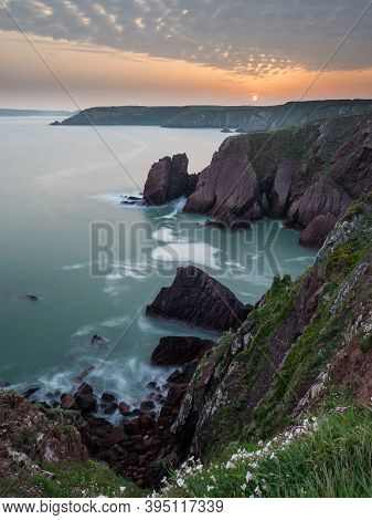 A Potrait Image Of Rooks Nest Point On The Coast Path In Pembrokeshire At Sunset Showing The Curving