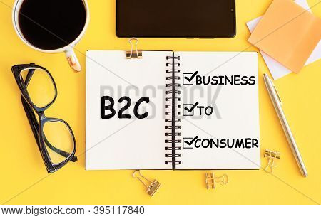 On The Table Lies A Smartphone, Coffee, Glasses, Pen And A Notebook With The Inscription- B2c. Busin