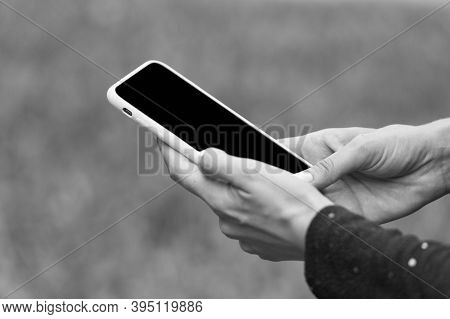 Phone For Keeping In Touch. Mobile Phone In Female Hands. Cell Phone With Touchscreen Technology. Ph