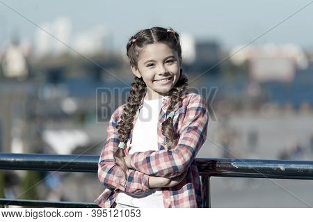 Leisure Options. Free Time And Leisure. Girl Cute Kid With Braids Relaxing Urban Background Defocuse