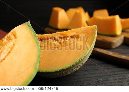 Tasty Fresh Cut Melon On Black Wooden Table, Closeup