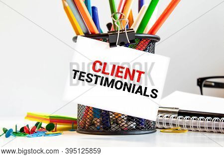 Client Testimonials Memo Written On A Notebook With Pen.