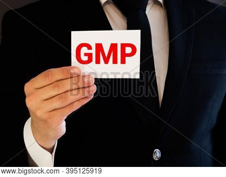 Businesswoman Holding Card With Gmp Message. Concept