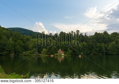 The Lake House Surrounded By A Beautiful Mountain Landscape With Beautiful Green Colors That Offer T
