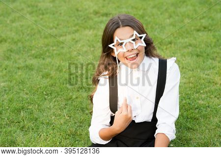 Be Pretty And Party On. Happy Kid Wear Star-shaped Glasses Green Grass. Party Look Of Small Schoolch