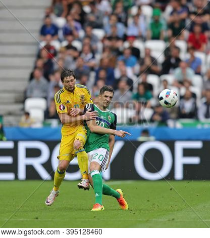 Lyon, France - June 16, 2016: Yevhen Seleznyov Of Ukraine (l) Fights For A Ball With Craig Cathcart