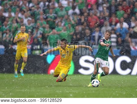 Lyon, France - June 16, 2016: Yevhen Konoplyanka Of Ukraine (l) Fights For A Ball With Jamie Ward Of