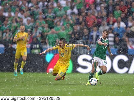 Lyon, France - June 16, 2016: Yevhen Konoplyanka Of Ukraine (l) Fights For A Ball With Jamie Ward Of