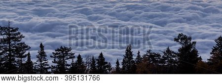 A Thick Cloud Layer With A Wave Like Texture Lit By Dawn Sits Lower Than The View Point Of The Sandi