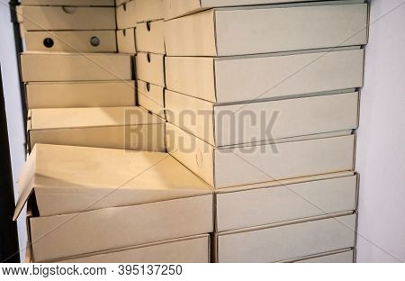 Stack Of Recycle Papaer Square Boxes On White Wall Background.