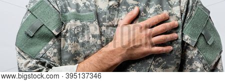 Partial View Of Military Man In Uniform Pledging Allegiance Isolated On White