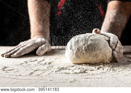 Photo Of Flour And Men Hands With Flour Splash. Cooking Bread. Kneading The Dough. Yeast Dough For B