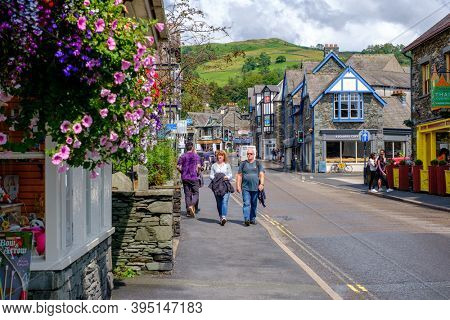 AMBLESIDE, UK - AUGUST 9,2019 : The colorful village of Ambleside on the picturesque Lake District in England