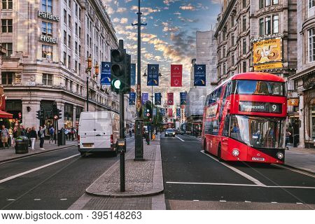 LONDON,UK - JULY 29,2019 : Street scene with double decker bus at The Strand in London