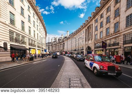 LONDON,UK - AUGUST 19,2019 : One of the iconic London taxis at Regent Street, a major shopping street famous for its architecture and its flagship stores