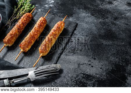 Lula Kebab. Shish Kebab On A Stick, From Ground Beef Meat. Black Background. Top View. Copy Space