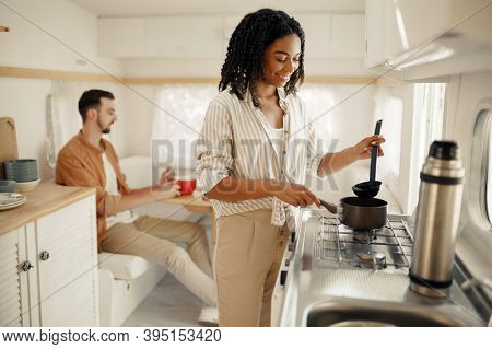 Love couple cooking in rv kitchen, camping