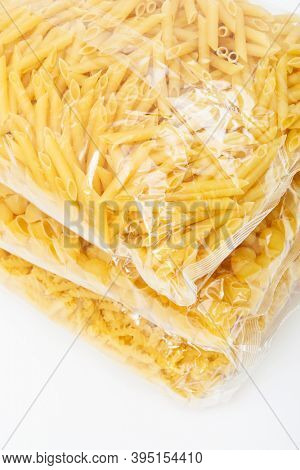 packets of pasta on a white background