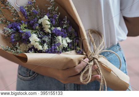 Statice, Sea Lavender, Marsh Rosemary, White And Purple Color A Bouquet Of Flowers In A Woman Hand