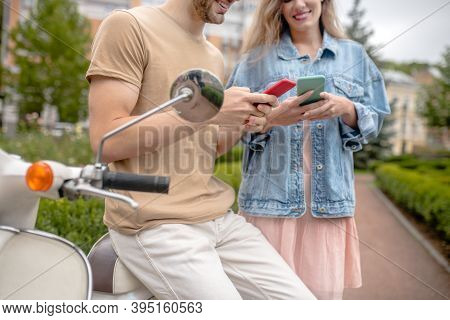 Man And Woman Surfing The Nternet Via Smartphones