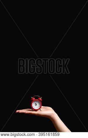 Time Reminder. Late Hour. Midnight Alert. Procrastination Delay. Woman Hand Holding Retro Miniature