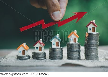 Businessman Holding  Graph Over Coins Money Setting Growth Up Increase To House Model For Concept In
