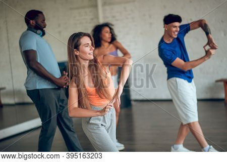 Group Of People Learning New Movements During Th Dance Class