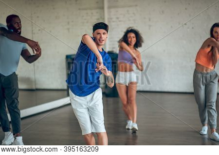 Teacher Showing New Dance Routine To His Students