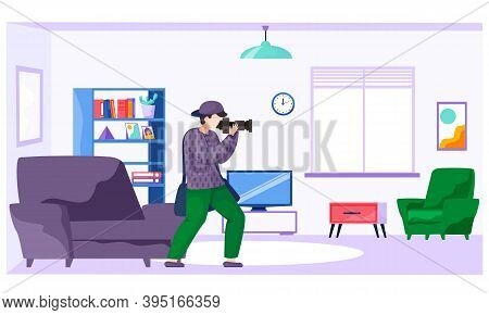 The Guy Standing And Adjusting The Lens. Photographer With A Camera Makes Pictures In The Apartment.