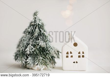 Cozy Winter Home, Christmas Scene, Miniature House With Lights And Snowy Tree. Christmas Lights, Lit