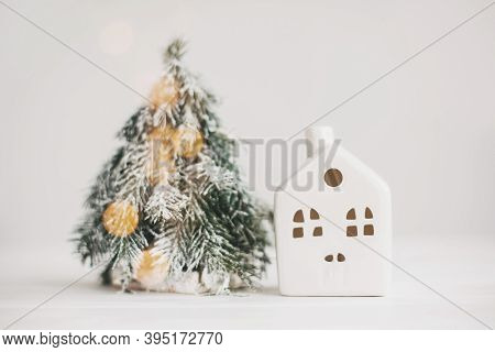 Merry Christmas ! Christmas Scene, Miniature House With Lights And Snowy Tree. Cozy Winter Home. Chr