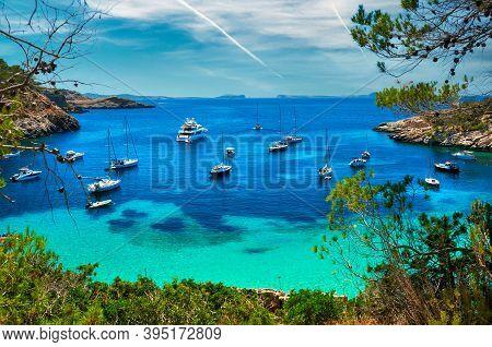 Moored Vessels, Sailboats, Yachts, Motorboats At Cala Salada Turquoise Lagoon Cove. Idyllic Beautifu