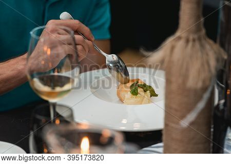 Portion Of Sorbet With Melon Balls And Mint Leaves Served On A White Platein A Restaurant . Closeup