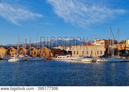 Old Venetian Port, Chania, Crete, Greece. Sailboats, Yachts, Pier, Shipyards Or Arsenali Veneziani O