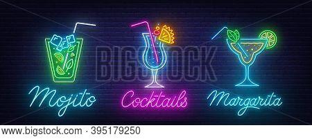 Cocktail Margarita, Blue Hawaiian And Mojito Neon Sign On Brick Wall Background.