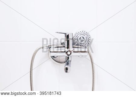 Hand Shower On The White Wall In Bathroom. High Quality Photo
