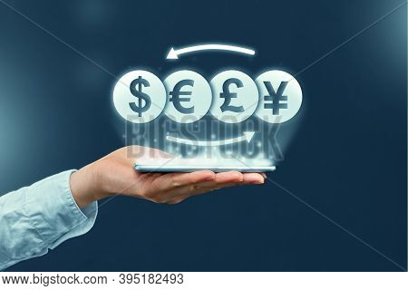 Currency Exchange Concept And Through A Mobile Application On A Smartphone.