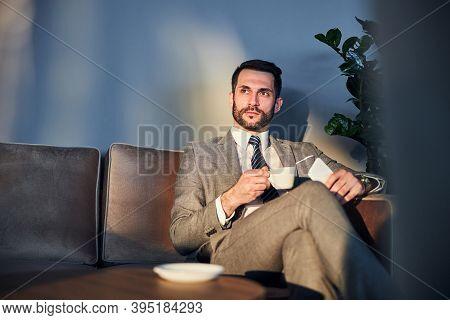 Entrepreneur With A Beard Savoring His Coffee