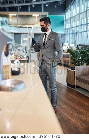 Entrepreneur Deciding About His Meal While Touching A Glass Case
