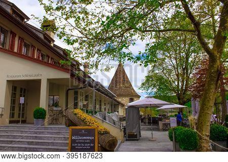 Schaffhausen, Switzerland - May 01, 2017: The View On Schloss Laufen Restaurant, Tower. Castle On Rh